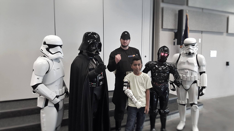 Illustration for article titled Darth Vader Delivered A 3D Printed Arm To Boy In Need
