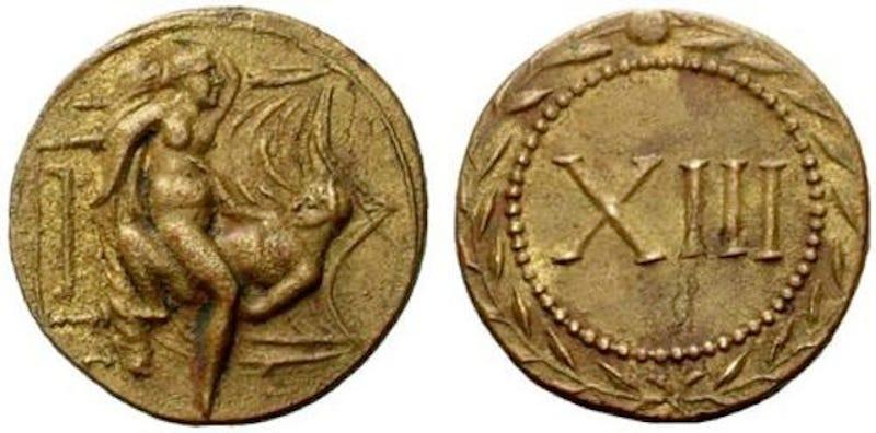 Древние монеты-спинтрии.
