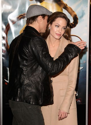 Illustration for article titled Brad Whispers To Angelina; Angelina Pretends To Listen