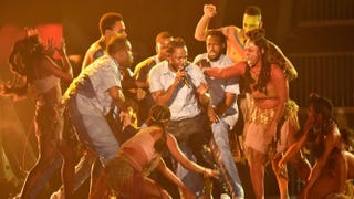 Kendrick Lamar (center) performs onstage during the 58th Grammy Awards at Feb. 15, 2016, in Los Angeles.Kevork Djansezian/Getty Images for NARAS