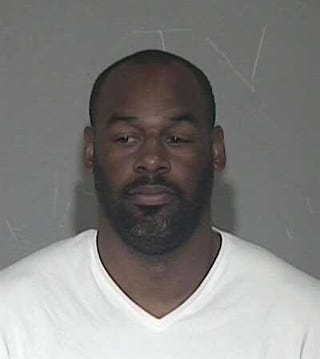 Illustration for article titled What The Hell Is Going On With Donovan McNabb's Mug Shot? [Update]