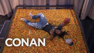 "Marshawn Lynch Dives Into ""End Zone"" Full Of Skittles On <i>Conan</i>"