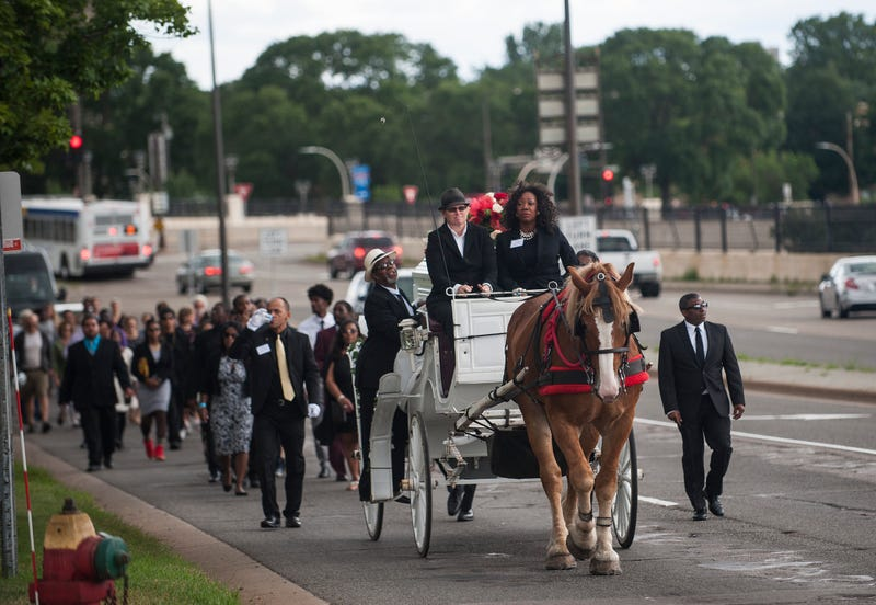 A horse-drawn carriage leads a procession carrying the casket of Philando Castile on July 14, 2016, in St. Paul, Minn.Stephen Maturen/Getty Images