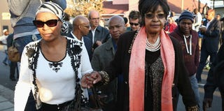 Winnie Madikizela-Mandela, right, leaves after speaking to the press outside Nelson Mandela's home. (Dan Kitwood/Getty Images)