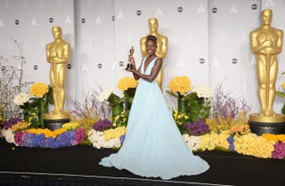 Lupita Nyong'o winner of Best Performance by an Actress in a Supporting Role poses in the press room during the Oscars at Loews Hollywood Hotel on March 2, 2014 in Hollywood, California.Photo by Jason Merritt/Getty Images
