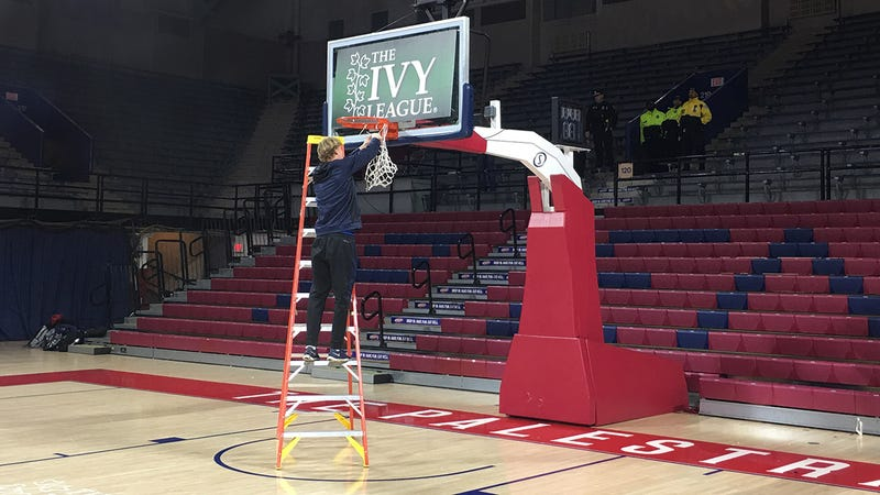 Penn senior Sam Jones cuts down the nets at The Palestra early Sunday morning.
