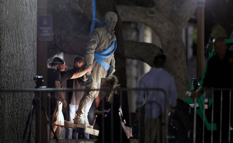 A statue of Confederate Gen. Robert E. Lee is removed from the University of Texas, Austin, campus, during the early  morning of Aug. 21, 2017. (Eric Gay/AP Images)