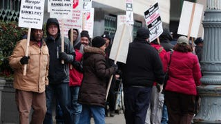 Protesters outside the courthouse during Detroit's federal bankruptcy rulingBill Pugliano/Getty Images