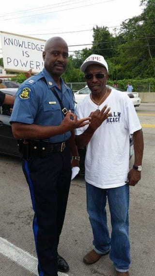 Capt. Ron Johnson and a member of Kappa Alpha Psi FraternityTwitter @DearRanda