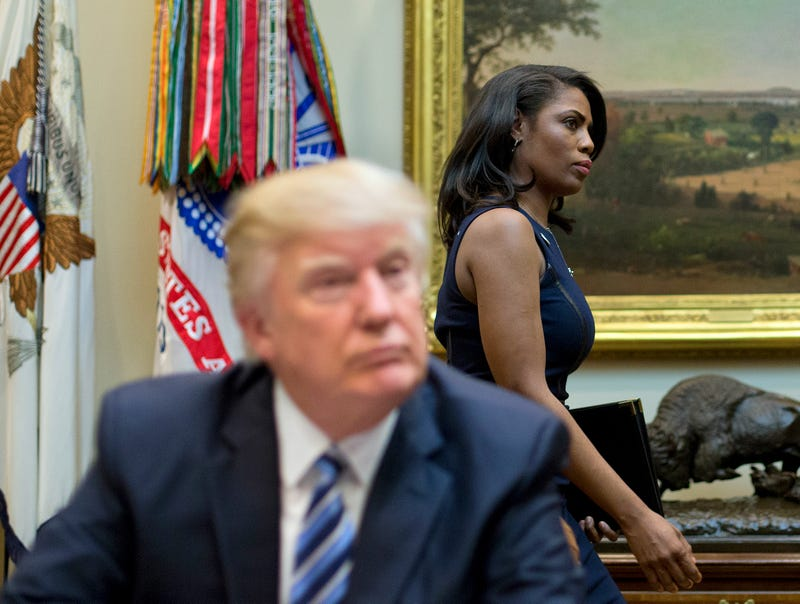 """In this March 12, 2017 file photo, White House Director of communications for the Office of Public Liaison Omarosa Manigault, right, walks past President Donald Trump during a meeting on healthcare in the Roosevelt Room of the White House in Washington. Manigault Newman, who was fired in December, released a new book """"Unhinged,"""" about her time in the White House."""