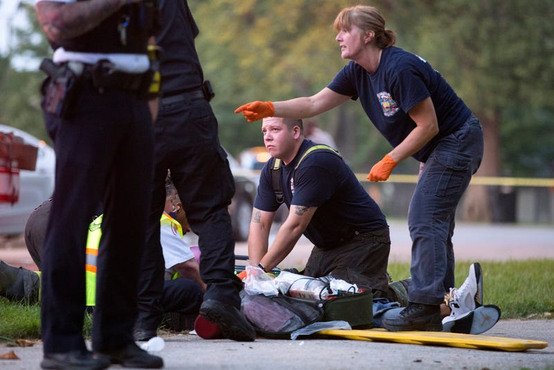 Members of the Chicago Fire Department work on a gunshot victim at the scene of a double shooting in the Englewood neighborhood of Chicago on Labor Day, Sept. 5, 2016.Erin Hooley/Chicago Tribune/TNS via Getty Images