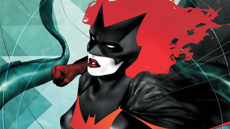 Kate doing what she does best, looking fab and fighting crime, on the cover of Batwoman #9.