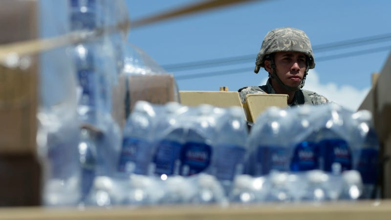 National Guardsmen arrive at Barrio Obrero in Santurce to distribute water and food among those affected by the passage of Hurricane Maria, in San Juan, Puerto Rico, Sunday, Sept. 24, 2017. Image credit: Carlos Giusti/AP Images
