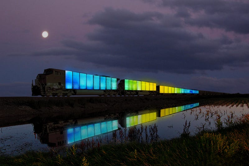 Illustration for article titled This Glowing Train Is Bringing Art, Music, and Yurts to Middle America