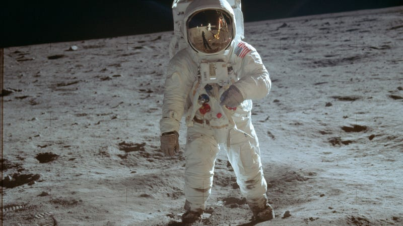 "A famous photo of astronaut Buzz Aldrin walking on the lunar surface after disembarking from the Apollo 11 Lunar Module (LM) ""Eagle""."