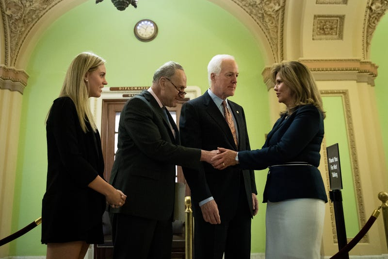 Sen. Chuck Schumer (D-N.Y., second from left) and Sen. John Cornyn (R-Texas, second from right) speak with Kaitlyn Strada (left) and Terry Strada (right), wife of Thomas Strada, who died in the 9/11 attacks, after a news conference concerning the Justice Against Sponsors of Terrorism Act on Capitol Hill in Washington, D.C., on May 17, 2016.  Drew Angerer/Getty Images