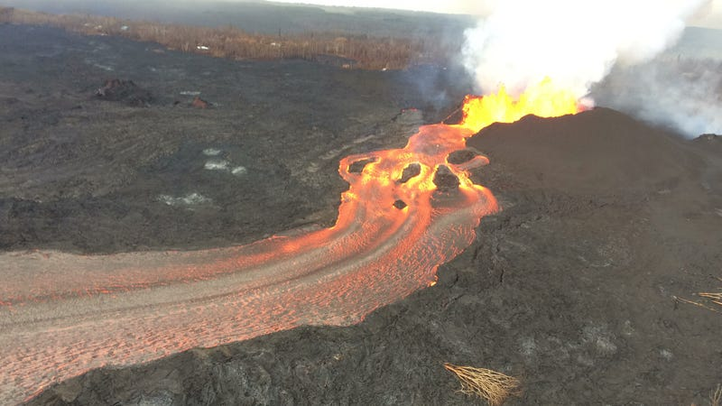 Lava streams through a channel from Fissure 8 (right) to the ocean in Kapoho bay.
