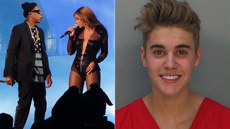 Illustration for article titled Beyoncé and Jay Z Display Justin Bieber's Mug Shot During Concert