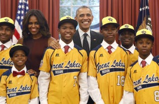 President Barack Obama and first lady Michelle Obama with the Jackie Robinson West All Stars in the White House Nov. 6, 2014YURI GRIPAS/AFP/Getty Images