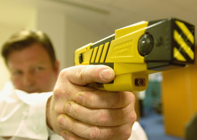 A policeman holds the new advanced taser gun April 4, 2003, as the Metropolitan police introduced the Taser gun to the press in London.