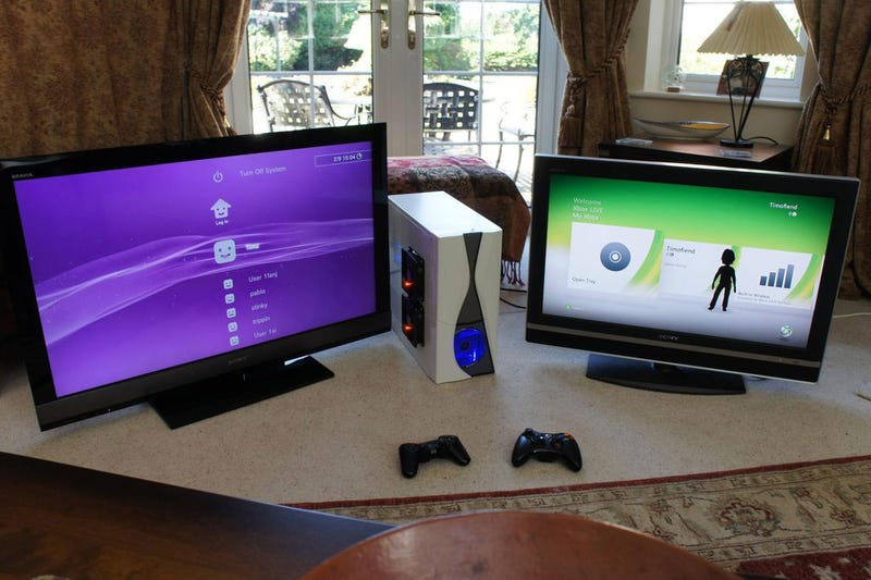 Illustration for article titled Guy Merges Xbox 360 and PlayStation 3 Into One Single Console