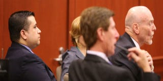 George Zimmerman and his defense team (Getty Images News)