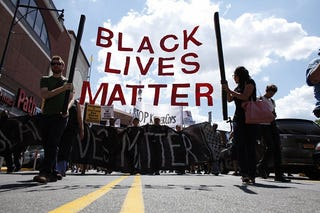 Demonstrators march during a Michael Brown memorial protest in Brooklyn, N.Y., on Aug. 9, 2015.KENA BETANCUR/AFP/Getty Images