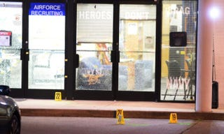 Evidence markers sit on the ground at the scene of a shooting in the parking lot of the Armed Forces Career Center and National Guard recruitment office July 16, 2015, in Chattanooga, Tenn.Jason Davis/Getty Images
