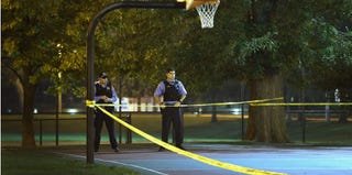 Police investigate the shooting in Cornell Square Park in Chicago on Sept. 19, 2013. (Scott Olson/Getty Images)