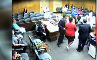 Attorney Andrea Burton being removed from court by a bailiff for wearing a Black Lives Matter button. Judge Robert Milich sentenced her to five days in jail for being in contempt.WKBN Screenshot
