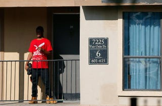 A man stands outside a unit at the Ivy Apartments in Dallas, where the first confirmed U.S. Ebola-virus patient was staying with family members, on Oct. 1, 2014.Tom Pennington/Getty Images