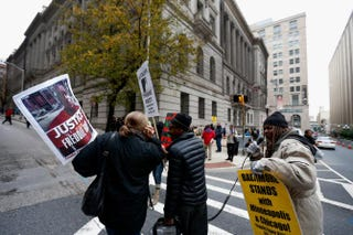 Protesters cross a street in front of the courthouse where jury selection began in the trial of William Porter, one of six Baltimore City police officers charged in connection with the death of Freddie Gray, on Nov. 30, 2015, in Baltimore.Rob Carr/Getty Images