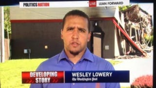 Wesley Lowery reports from Ferguson, Mo., before his arrest Aug. 13, 2014.Twitter/@bzref