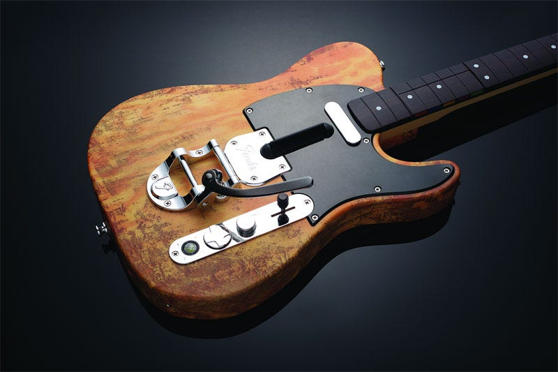 Illustration for article titled Mad Catz's Wireless Fender Telecaster Is Distressed
