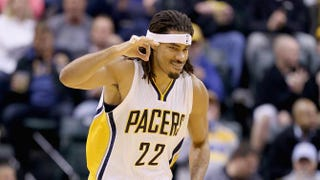Chris Copeland of the Indiana Pacers celebrates after making a three-point shot during a game against the Memphis Grizzlies at Bankers Life Fieldhouse Oct. 31, 2014, in Indianapolis.Andy Lyons/Getty Images