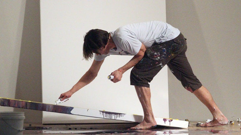 Carrey at work in his studio in 2010. (Photo: Philip Ramey Photography, LLC / Getty Images)