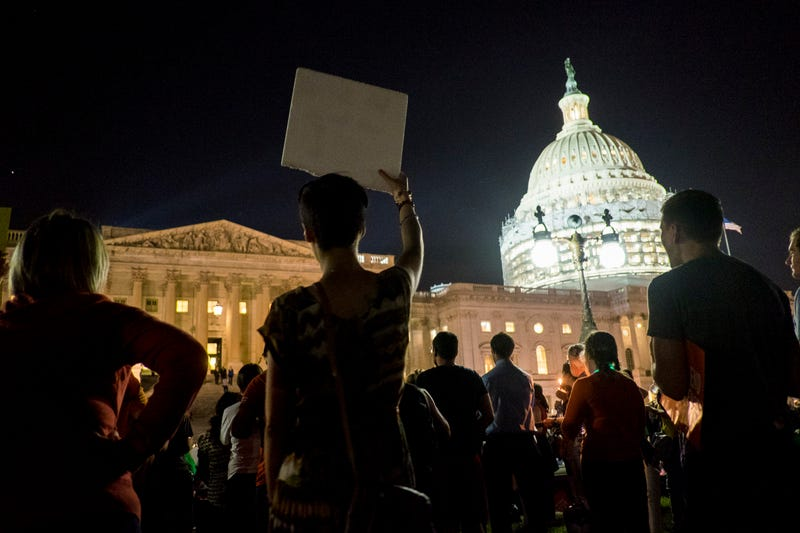 Supporters of House Democrats taking part in a sit-in on the House floor shout encouragement from outside the U.S. Capitol  in Washington, D.C., on June 22, 2016.Pete Marovich/Getty Images