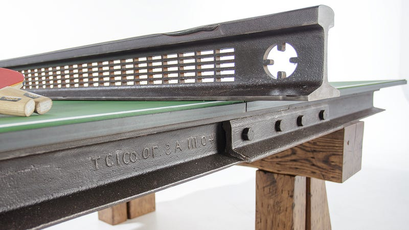 Steel And Wood From A Salvaged Railroad Support This Rustic Ping Pong Table