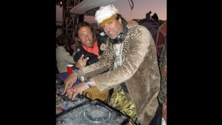Illustration for article titled Here's Rony Seikaly Looking Like A Haggard Drag Queen While DJing At Burning Man