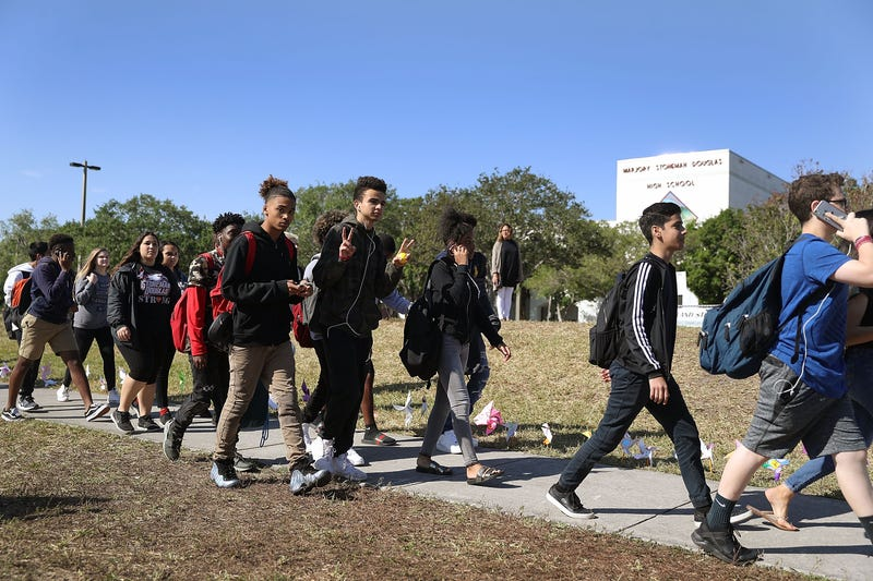 Students from Marjory Stoneman Douglas High School walk out of school March 14, 2018, to honor the memories of the 17 people killed during a mass shooting at the Parkland, Fla., school a month earlier.