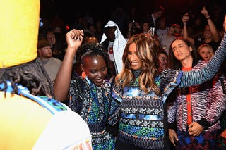Lupita Nyong'o, Iman and climate-change activist Xiuhtezcatl Martinez dancing Oct. 19, 2016, in New York City (Dimitrios Kambouris/Getty Images for H&M)