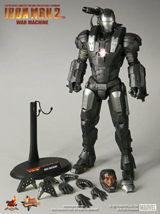 Illustration for article titled How Does War Machine's Gun Work? Can He Sit Down? New Toy Pics Reveal All!