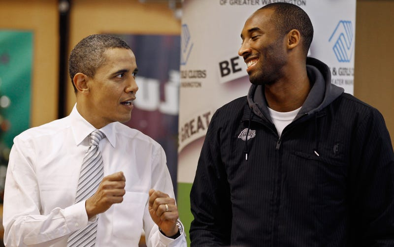 President Barack Obama (L) talks with Kobe Bryant of the Los Angeles Lakers while filling care packages during a NBA Cares service event at the Boys and Girls Club December 2010 in Washington, DC. Bryant and all the members of the 2010 NBA Championship Lakers team volunteered on projects at the club before being honored by the president for their victory.