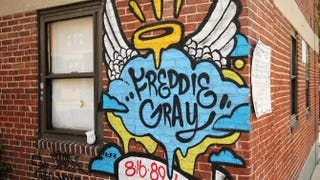 "A mural memorializing Freddie Gray is painted on a wall at the Gilmor Homes housing project in Baltimore where tenants accused maintenance workers of demanding ""sex-for-repairs.""Chip Somodevilla/Getty Images"