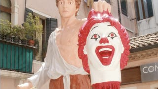 Illustration for article titled Italian artist transforms Ronald McDonald into the decapitated head of Medusa
