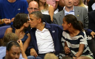 Kiss cam: the president and first lady Michelle Obama at a sporting event July 17, 2012.The Washington Post/Getty Images