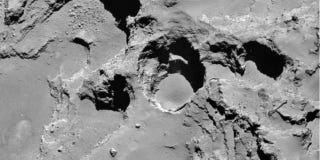 Illustration for article titled Rosetta's Comet Is Developing Giant Sinkholes Before Our Eyes