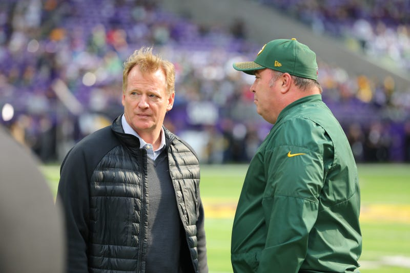 NFL Commissioner Roger Goodell and Green Bay Packers head coach Mike McCarthy talk during warmups Oct. 15, 2017, at U.S. Bank Stadium in Minneapolis. (Adam Bettcher/Getty Images)
