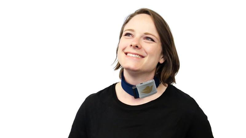 A woman wearing a Dove-branded shock collar.