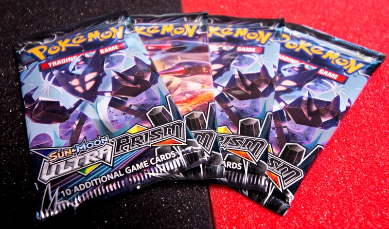 Illustration for article titled Let's Open Some Pokemon Ultra Prism Cards And See If There's Anything Good